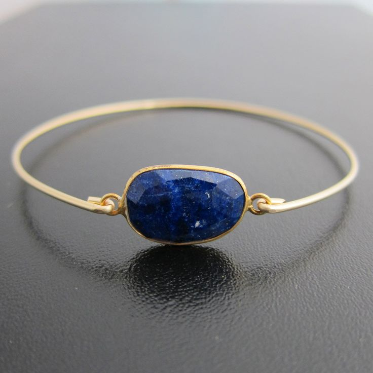 Navy Blue Lapis Lazuli Bracelet - 14k Gold Filled Bangle - Genuine Gemstone - Lapis Lazuli Jewelry, Lapis Lazuli Bangle, Lapis Bracelet. $39.95, via Etsy.