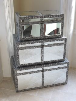 This silver embossed metal mirrored trunk set is perfect for your bedroom storage.