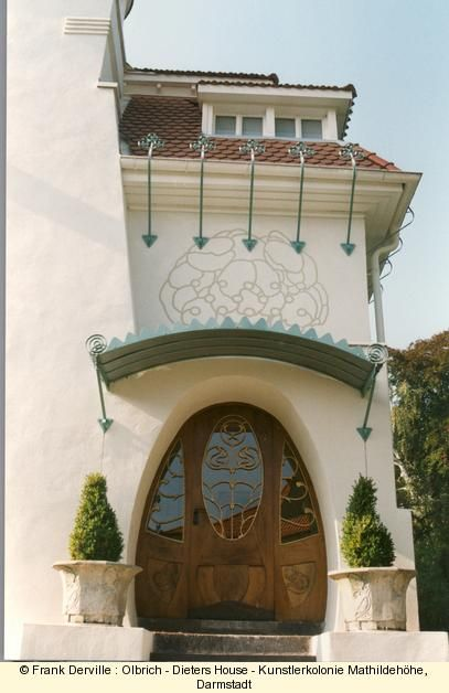 Hans Dieters House by Olbrich in 1900, the most interesting Art Nouveau house in Darmstadt. The main door is a jewel with its wooden flower sculpture to the bottom and its stylized organic golden barrels.