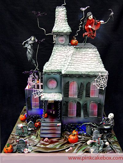Spooky Haunted Halloween House Cake by Pink Cake Box in Denville, NJ. More photos and videos at http://blog.pinkcakebox.com/spooky-haunted-house-cake-2009-10-31.htm