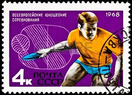 USSR CIRCA 1968 A stamp printed in the USSR shows a young man playing ping pong also known as table  Banco de Imagens