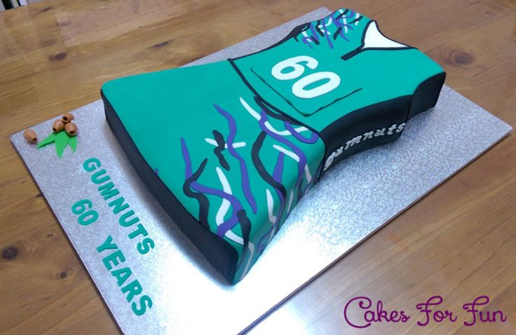Netball Dress Cake Here is a Netball Dress mud cake, filled with Ganache!