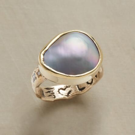 Our Jes MaHarry pearl and diamond ring catches the eye with its nacreous beauty.