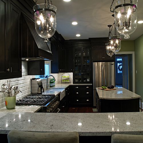 Dark cabinets, gray granite countertops, subway tiles