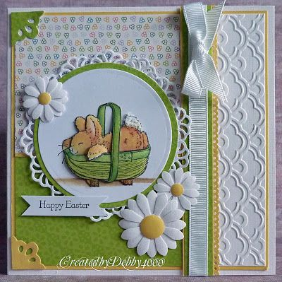 handmade Easter card ... sweet bunny asleep in a basket ... luv the fresh green and the punched daisies ...