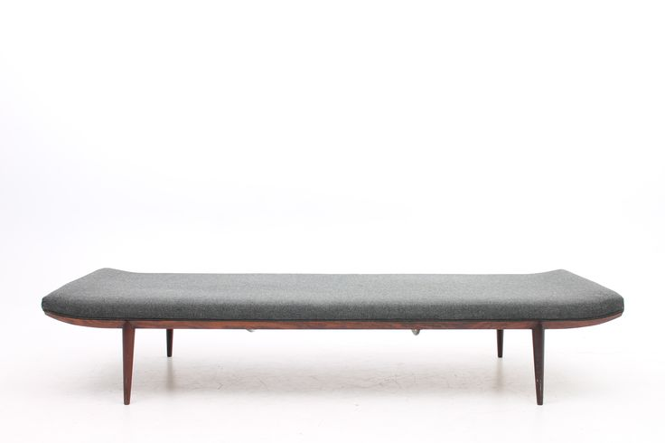 Daybed designed by Erik Riisager Hansen with sweeping rosewood frame, mounted on tapering legs. Seat upholstered with original grey wool. Produced in the 1960s by Haslev Møbelsnedkeri, Denmark. www.reModern.dk