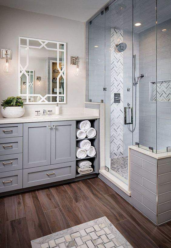 Grey Bathroom Tiling This sophisticated grey look is all about creating a high end atmosphere for the entire bathroom. The finished product exudes a clean look, with uncomplicated and clearly delineated lines, that is instantly appealing.