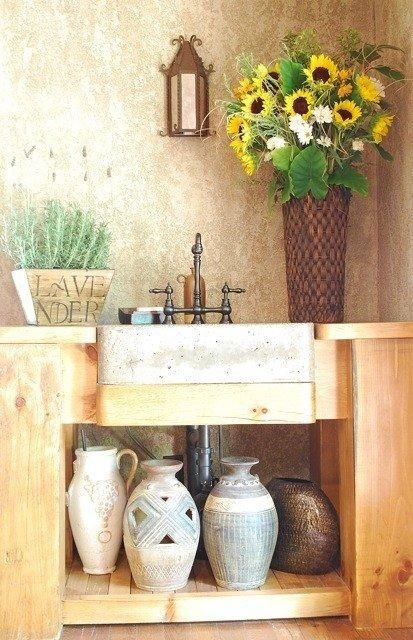 Tuscan kitchen prep area complete with concrete sink. Sunflowers are not tacky if done correctly! Downstairs bath