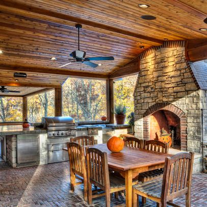 Fireplace under deck drainage system under deck deck for Outdoor kitchen and fireplace designs
