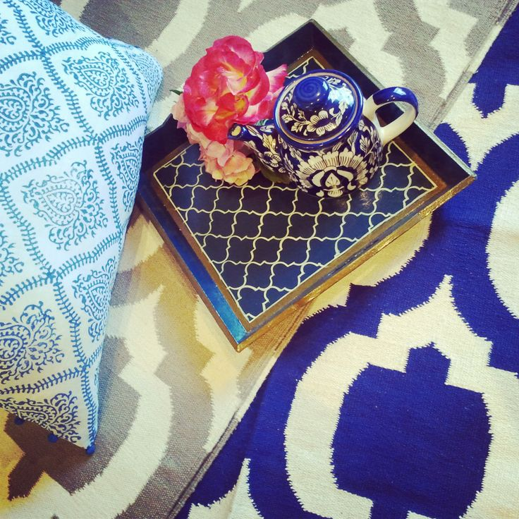 Oh how I love Indigo, blues as well as browns. These carpets are my designs from my first range inspired by the architecture while I visited Jaipur....the cushion is our latest blue scroll handblock printed linen cushion with little pom poms perfect, a lovely bedroom cushion I say & the handpainted tray is something I am working on in the coming year. www.shakiraaz.com.au