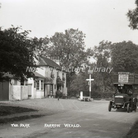 Outside the Hare Public House, Harrow Weald Middlesex featuring a London Transport Bus. 1900