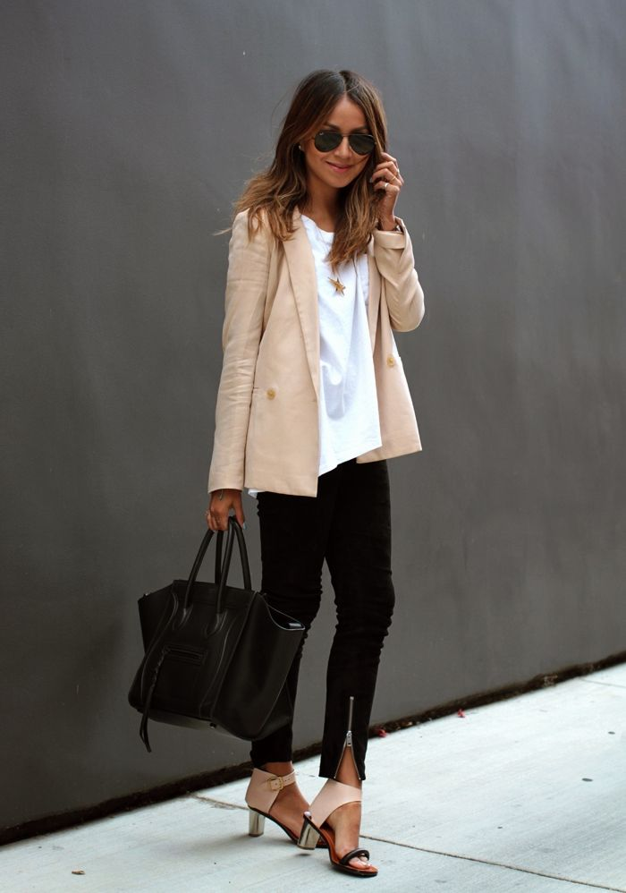 Give a jeans-and-tee look polish by adding a sophisticated blazer, structured handbag, and fun shoes.