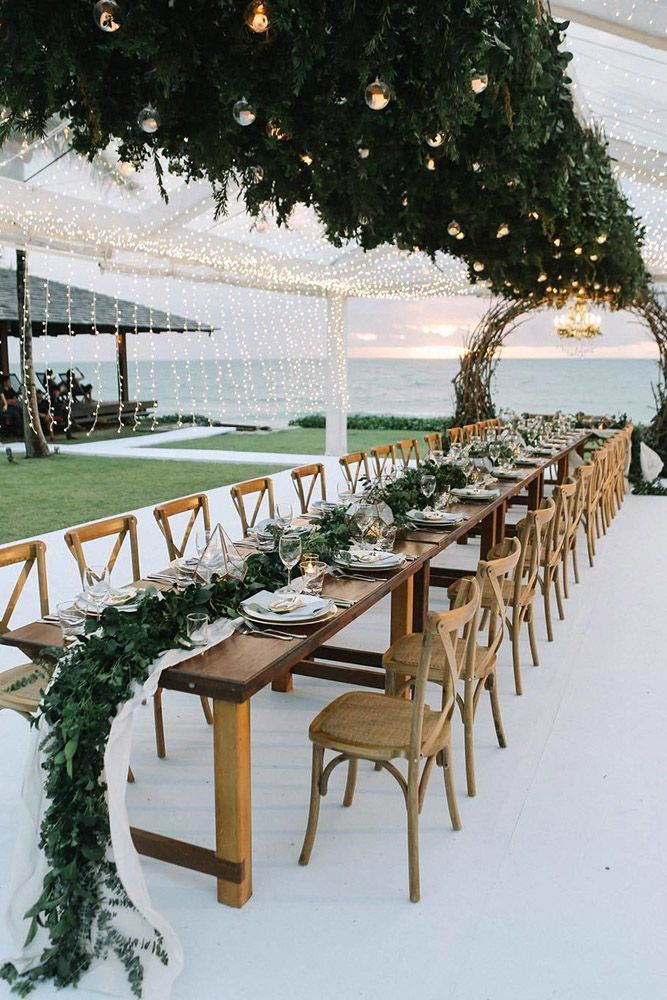 wedding trends 2019 long chic rustic table with greenery and gold geometry centerpieces on the beach axioo