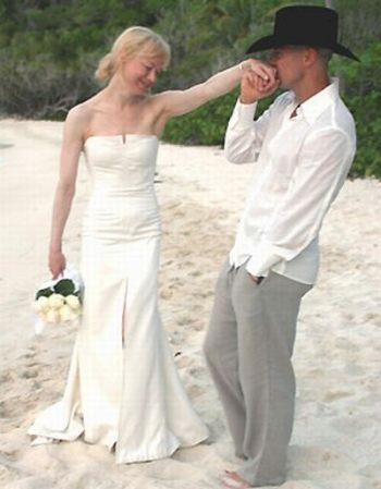 Renee Zellweger wedded Kenney Chesney on St. John in the Virgin Islands. Her beach wedding dress was a satin Carolina Herrera design....sweet, elegant and simple.