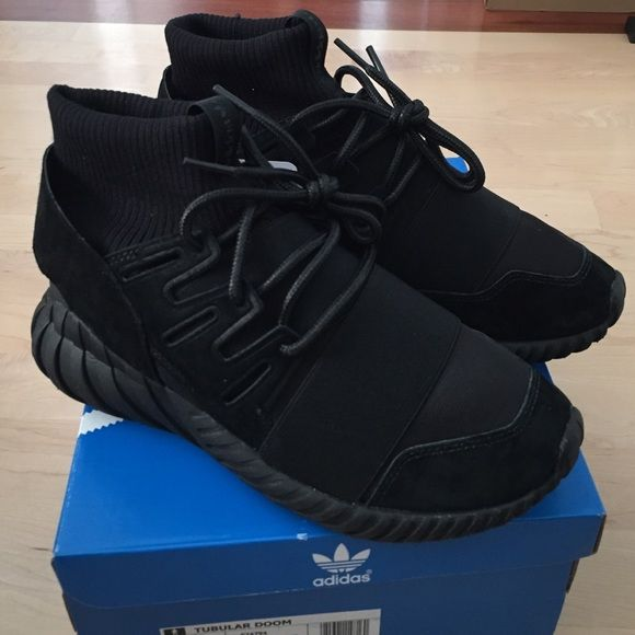 Adidas Tubular Doom Triple Black One of the newest drops from Adidas Originals. Sold out everywhere. 100% Authentic. Men's size 6. Women's size 7.5. Bought from caliroots. Im usually a size 8/8.5 in women's but these are too small for me so I'm selling to get another pair in my size. Adidas Shoes Sneakers