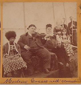 """Exceptional historic photograph c. 1872 of P T Barnum Circus Stereoview Card of his Sideshow Tent. Believed to be one of the earliest photographs of Barnum's Circus. Featured """"attractions"""" pictured L to R: Bartola (pinhead, half of the famous """"Aztec Wonders""""), John Hanson Craig (Kentucky Fat Boy), Mary Powers (Kentucky Giantess), Zip the """"What is It?"""", Annie Jones (Bearded Girl), unidentified Albino Woman with """"Circassian"""" type hair. Extraordinary photograph. *s*"""
