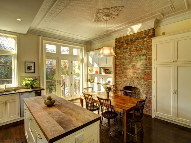 I love the fireplace in the kitchen. White Traditional Kitchen - 99 Beautiful Kitchen Island Design Ideas on HGTV