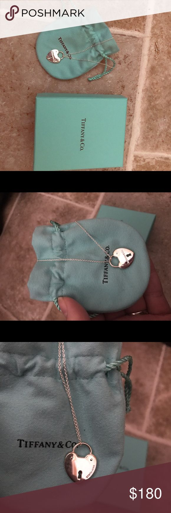Tiffany and Co heart locket pendent Brand new, never worn Tiffany and Co necklace. Necklace is a sterling silver heart locket pendent with a matching 18in sterling silver chain. Comes with dust bag and box! Price asking is $180 or best offer! So make an offer I'm open to anything! Tiffany & Co. Jewelry Necklaces