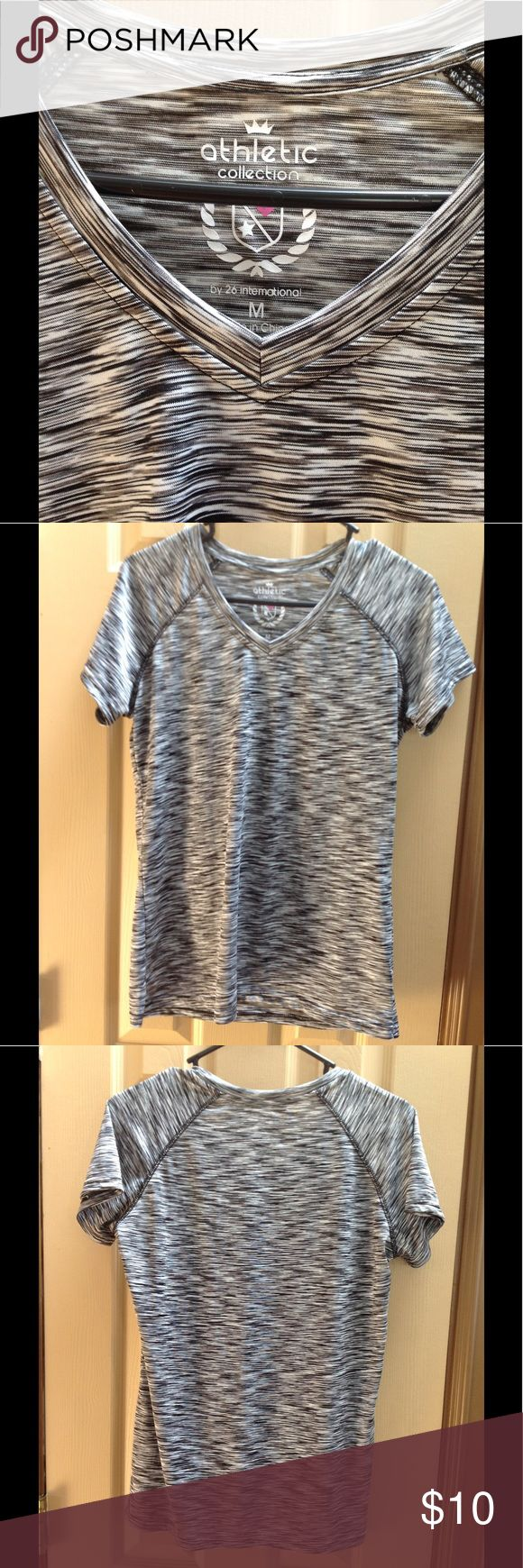 Black and white verigated v neck Athletic shirt ATHLETIC COLLECTION size Medium Brand New 100% polyester Black and white short sleeve Athletic collection Tops Tees - Short Sleeve