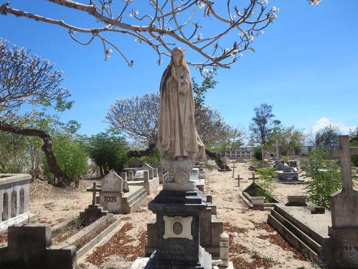 An image of the Virgin stands above the tomb of Joao Albuquerque Amaral (1907-1958) outside the Igreja de Nossa Senhora da Saúde at the southwest end of Mozambique Island.