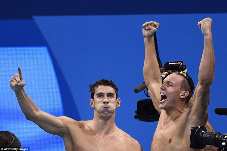 USA's Michael Phelps (L) and USA's Caeleb Dressel celebrate after team USA won…