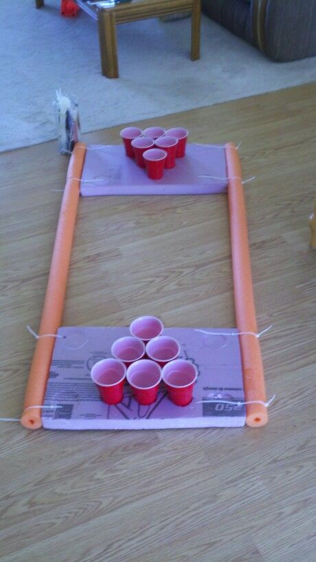 Homemade pool pong with some styrofoam, noodles, zip ties, and some good cutting techniques for cup pockets.