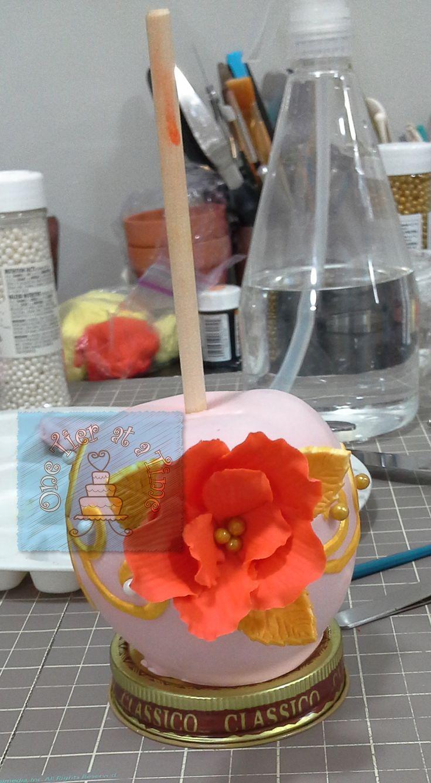 Chocolate covered apples, caramel apples, candy apples, fondant flower, gumpaste flower, burnt orange flower and gold