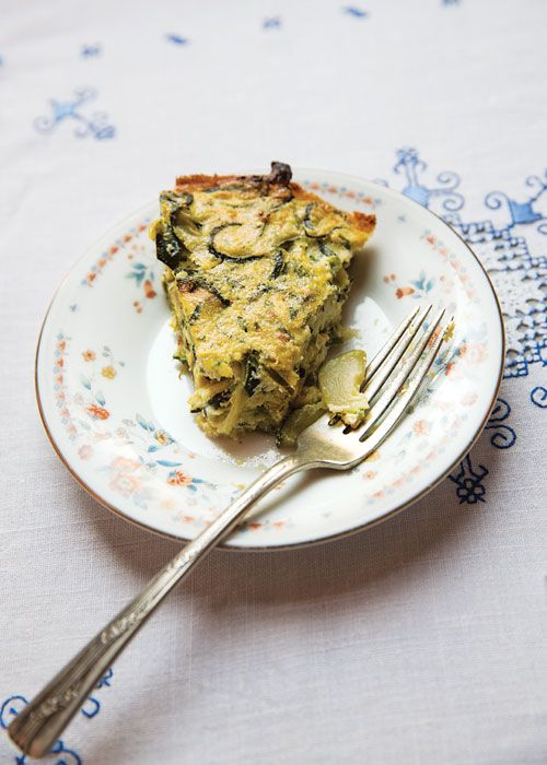 A savory summer pie with a base of fresh ricotta and eggs seasoned with shallots, garlic, and pecorino is the answer to an overly abundant vegetable crop. This version from Italy's Piedmont region is made with zucchini and onions, but feel free to substitute with peppers, eggplant, squash—even tomatoes.