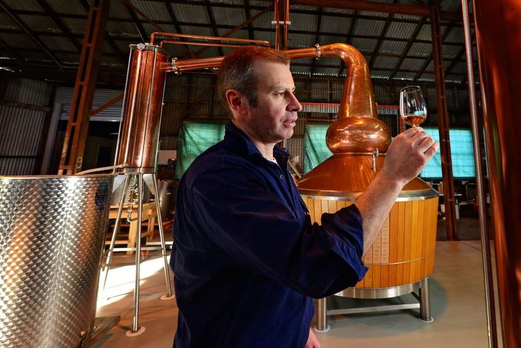 LIQUID GOLD: Launceston Distillery distiller Chris Condon with some of the product in the making. Distillery tours are available as part of this…