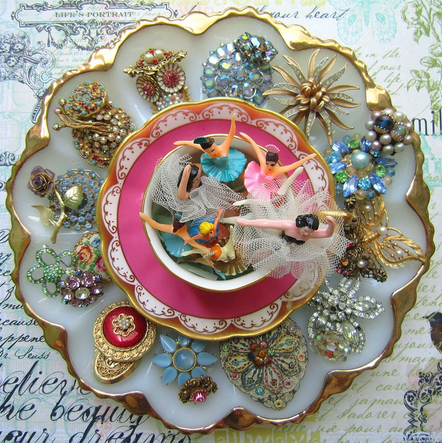 reuse an egg plate for a brooch holder ~ put something in the middle to hold other jewelry or trinkets ~ lovely