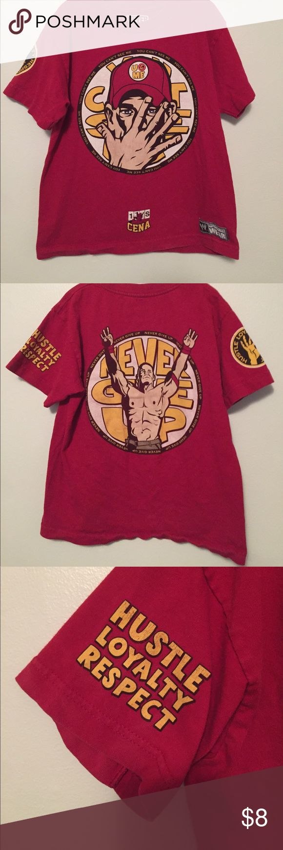 John Cena t-shirt This shirt is in good, used condition. See photos for signs of wear. A perfect shirt for any Cena fan! Tag says Large. My best guess for fit is 10/12. John Cena Shirts & Tops Tees - Short Sleeve