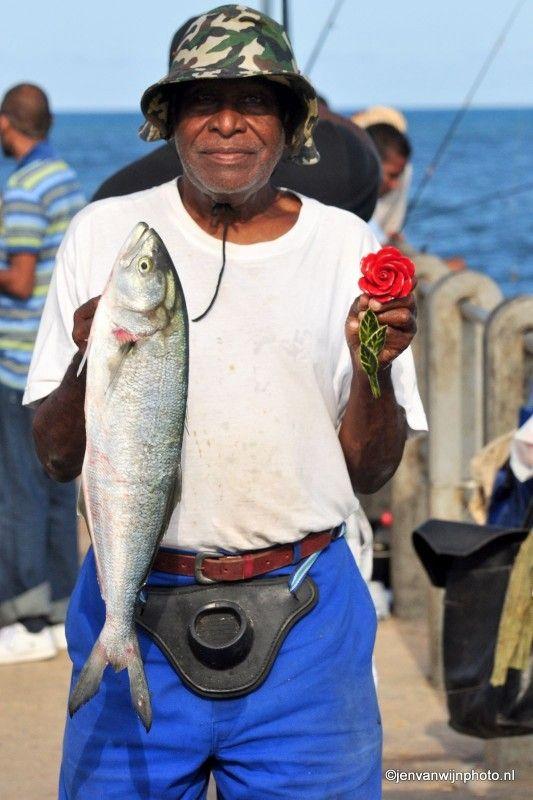 Visser Patrick blij met de vangst van vandaag by Jen van Wijngaarden Durban SA