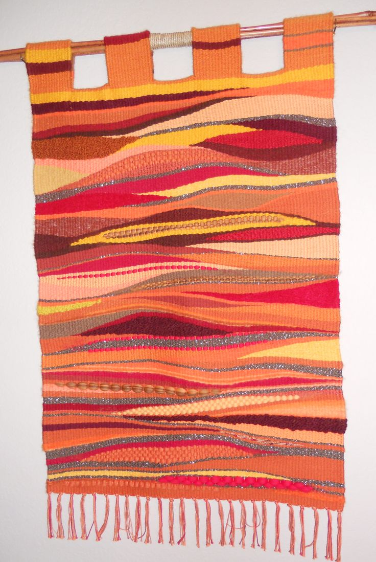 This Wall Hanging was done on a traditional floor loom but was woven using a tapestry weaving method. The design was totally free flow.