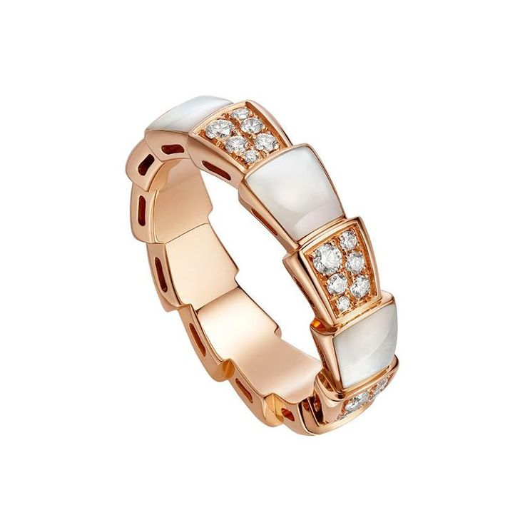 Bulgari Viper ring in rose gold with white mother of pearl and white diamonds. With snake scale-like inspired shapes around the band. Iridescent pearl. How jewellery designers are using mother of pearl in an up to date fashion forward way: http://www.thejewelleryeditor.com/jewellery/article/mother-of-pearl-jewellery-trend/ #jewelry