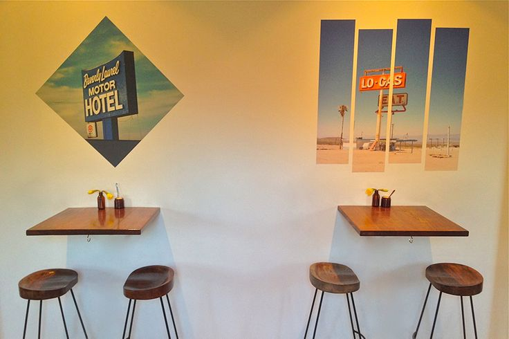 """Two of our decals on display in Gardiner & Field cafe.  On the left is """"Beverly Blue"""" by Amanda Fordyce, being a tribute to her love of L.A. retro signage.  The other one's  """"Lo Food & Gas"""" by the uber cool Dave Clark.  Windows to memories"""