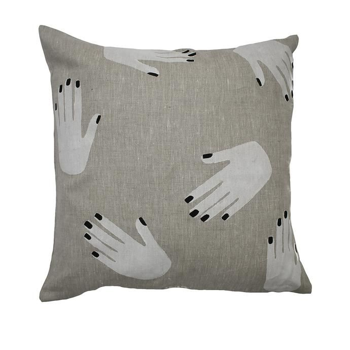 oatmeal linen cushion patterned with white hand prints with black nails