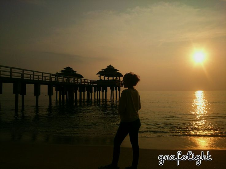 Women in the beautiful sunset -  Anyer, Banten