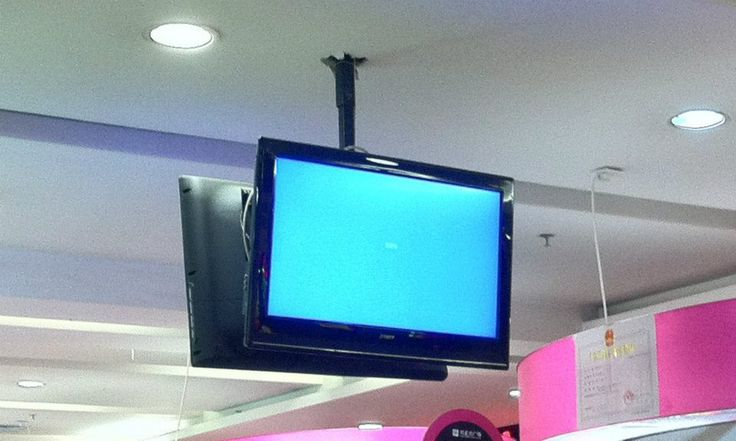 They used TVs for digital signage, no working content, and look at the installation job ! Just (literally) punch a whole in the ceiling and drop the pole through.