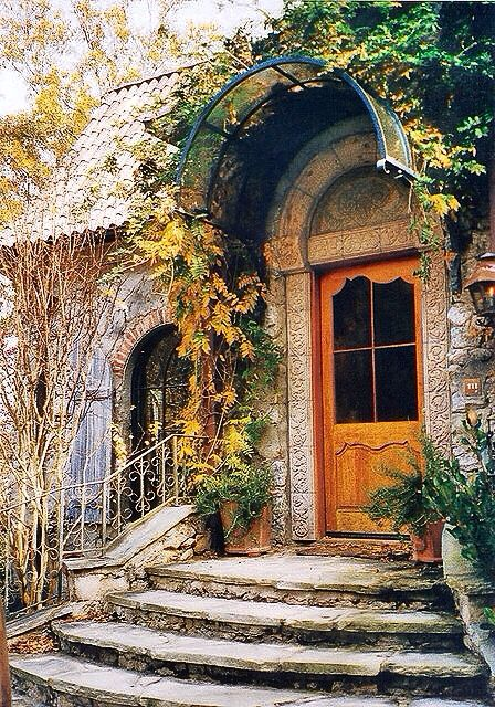 Another Country French Cottage by Leo Dowell Interiors. Leo designed the front door/ hand carved stone work/ the rubble stone/ the aged shutters and on and on. He handles exterior details and interiors as well.