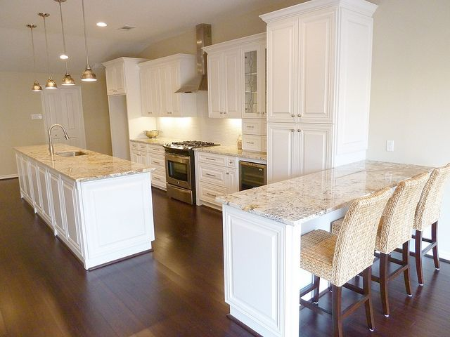 "Love ""White Springs"" granite with off white cabinets and seagrass bar stools (but I would like them dark brown)."