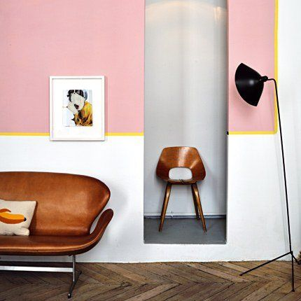 pink walls. leather swan couch. elle decor uk.