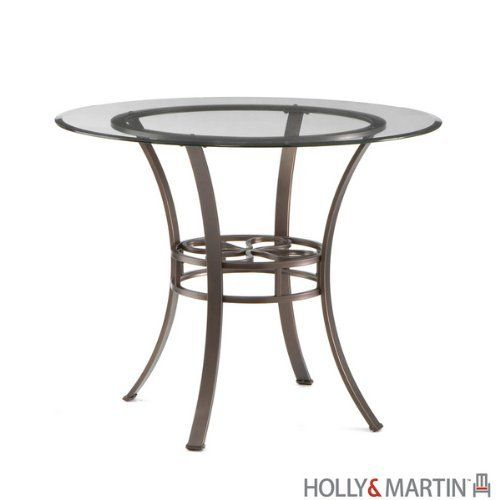 """Holly & Martin Paisley Dining Table with Glass Top by Holly & Martin. $199.99. Matching set of 4 chairs available - Sold Seperately. Metal and glass. Color: Dark Brown. Powder coated dark chocolate finish. Size: 30""""H x 38""""W x 38'D. Round in design, this transitional dining table creates the perfect blend of styles. The metal tube frame is powder coated with a dark brown texture with hints of bronze highlights. Each of the four legs curves up from the floor to meet the circular t..."""