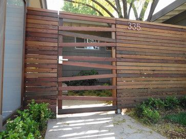 Panels framed in redwood & recycled redwood horizontal fence modern landscape.  Love the gate element.  Perhaps something similar for my yard... except dog proof.