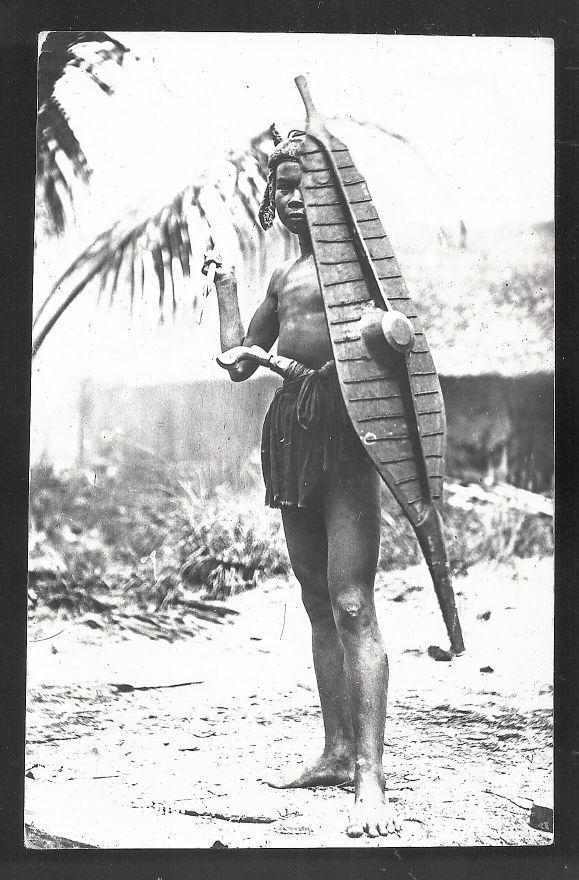 Dayak Warrior rppc Shield Borneo Indonesia 2 stamps 20s