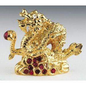 Feng Shui Dragon Symbol - Dragons as Powerful Feng Shui Cure - the gold dragon is an excellent addition to your wealth area while a green dragon will fit in well in your health area.