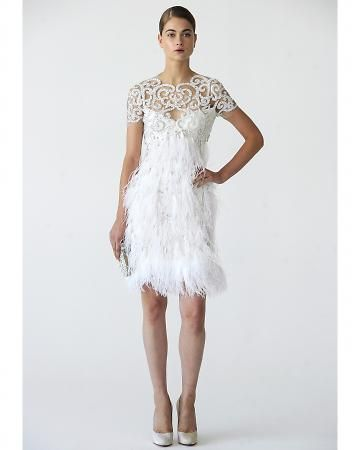 Marchesa cocktail length wedding dress. This embroidered tulle gown is finished with a fun and flirty feather skirt. Bo Son, marchesa.com