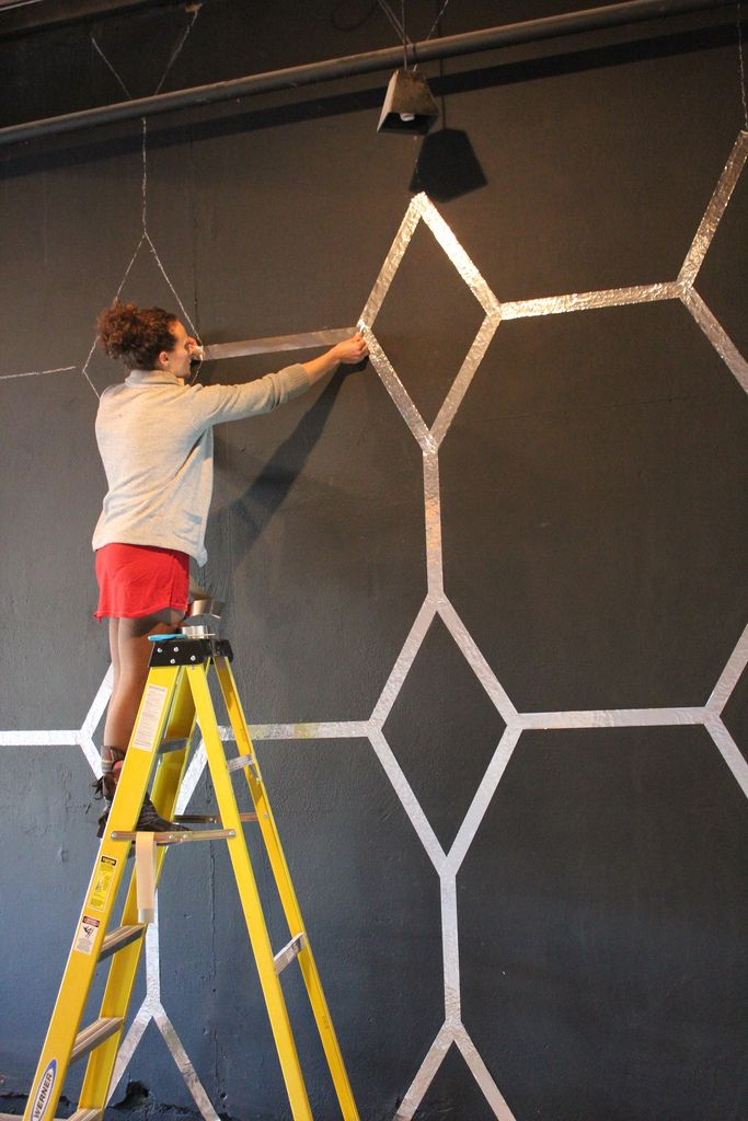 DIY: feature wall using a geometric shape and foil tape from karapaslaydesigns.blogspot.com - so creative & inexpensive but really creates a statement!