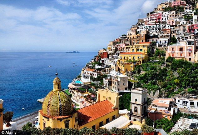 Positano, Italy. One of the 'jewels of the Amalfi Coast'. Not a bad spot for a honeymoon perhaps...;)