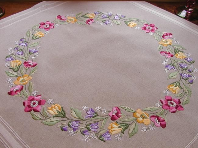 Very attractive tablecloth with a lovely hand made embroidered crown of flowers