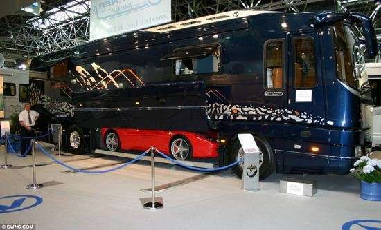 The Volkner Mobil luxury motor home is an estimated $2 million, and stores one's Ferrari in the belly of the beast.